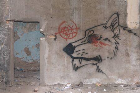 Tver. Quarter of old houses. Morozov barracks. Graffiti in one of the houses.