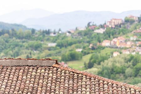 Clay tiles close-up. Old tiles on the houses of Tuscany. The old technology is better than the new ones.
