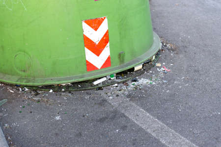Dumpsters on the streets of Rome. Container with glass with a fallen off bottom.