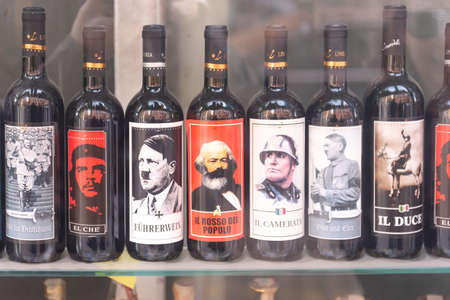 Rome, Italy. Spring 2020. A liquor store window. Wine with dictators on the labels. Tourist showcase in Rome