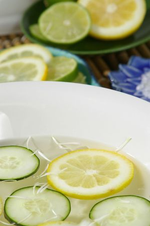 destress: Citrus bath in foreground, with ingredients in background area. Stock Photo