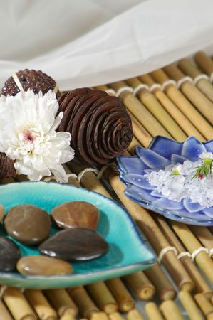 Herbal spa treatments on colorful asian plates.