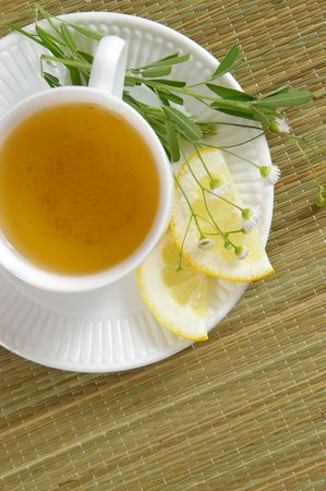 soothe: A cup of herbal tea, as viewed from directly overhead.