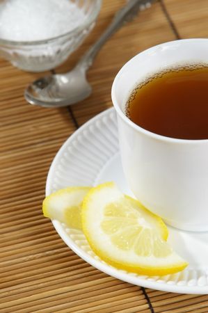 pekoe: Cup of hot tea with lemon and sugar.