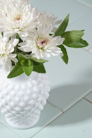 hobnail: White mums in a hobnail milk glass vase.