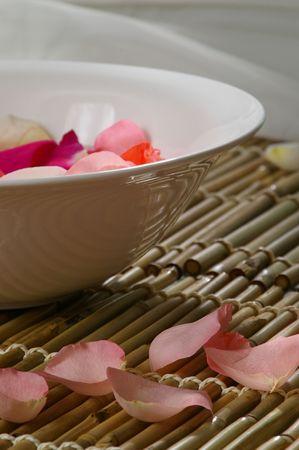destress: Rose petals float in a bowl. Spa-like setting.
