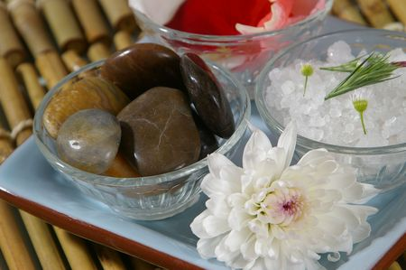 soothe: Spa tray- focus on massage rocks. Stock Photo
