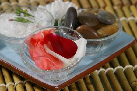destress: Spa tray- focus on rose petals. Stock Photo