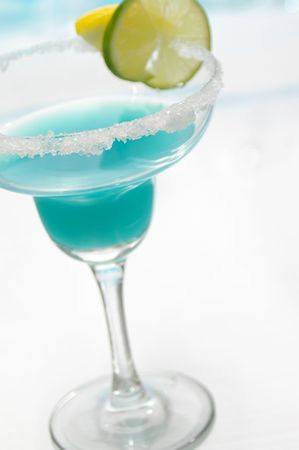 Blue margarita with selective focus on sugared rim. photo