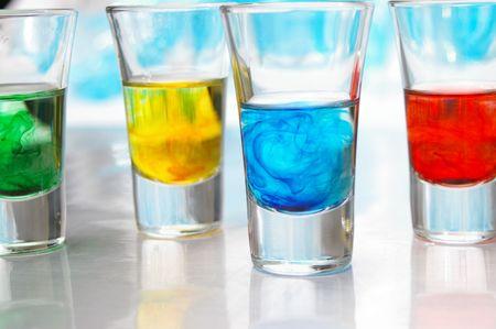 Brightly colored liquids in glass vials. 版權商用圖片