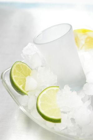 bartend: Chilled shot glass in ice with lemons and limes.