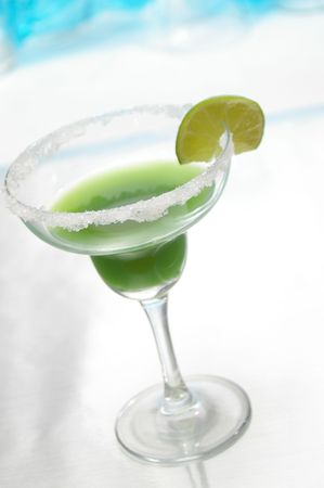 bartend: Green margarita in a traditional glass. Stock Photo