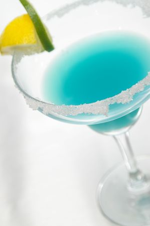 Blue margarita garnished with sugar, lemon and lime. Stock Photo - 442152