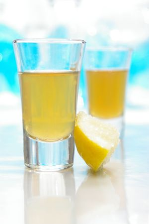 Two tequila shots, with lemon and salt.