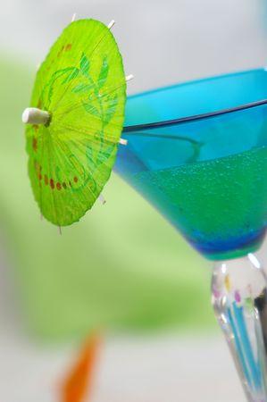 Bright green cocktail umbrella. photo