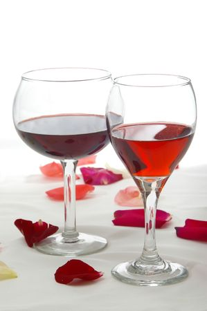 Red wines in a romantic setting.