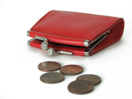 isolated red coin purse with five pennies