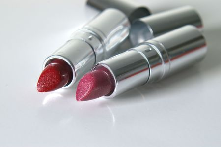Red & pink glittery lipstick in silver tubes.