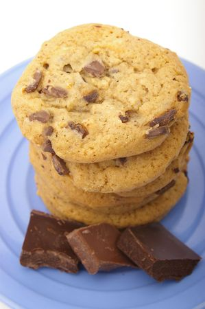 calorie rich food: A stack of delicious chocolate chip cookies with chocolate chunks.