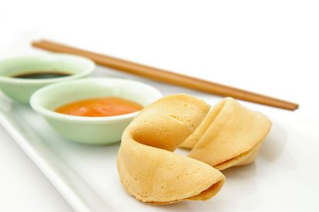 Fortune cookies on an asian sideplate. 版權商用圖片