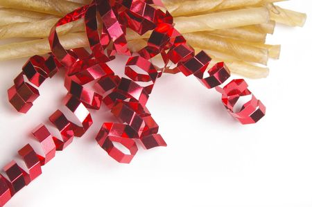 rawhide: Rawhide dog treats are bundled into a Holiday package.