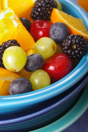 Closeup shot on a bowl of assorted colorful fruit. Shallow focus.