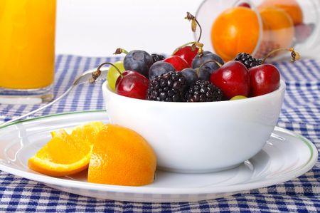 Assorted fruits on a cheerful morning table.