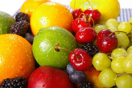 Freshly washed fruits with water droplets. Bright high key look conveys freshness.