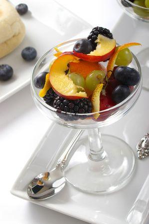 Elegant fruit salad in a stemmed glass.