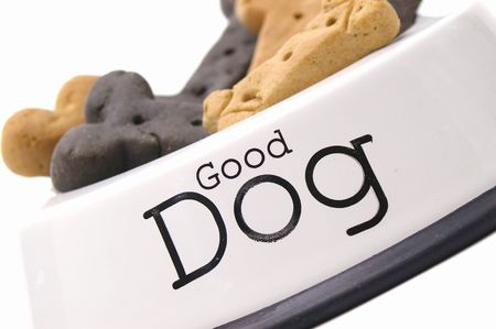 Designer dog treats in a bowl labeled Stock Photo - 1007584