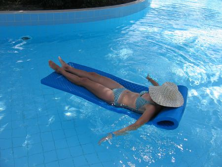 Woman in bikini relaxing in a pool