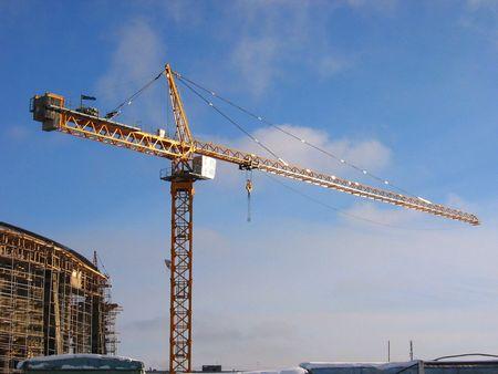 site: Construction site. Crane and building.