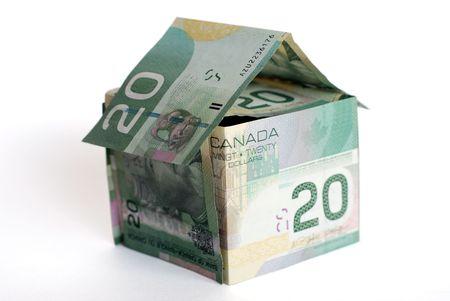 白い背景の上のカナダのお金の家