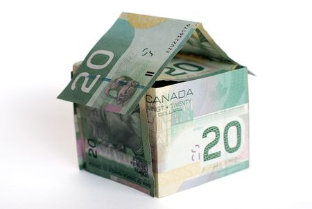 housing development: Canadian money house on white background