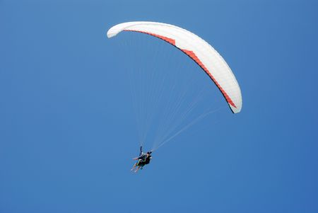 Paragliding duo in the air.