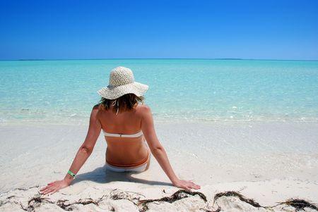 Woman relaxing on beach Standard-Bild