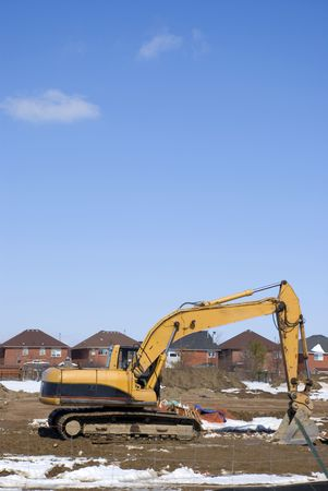 New house construction site with a buiidozer
