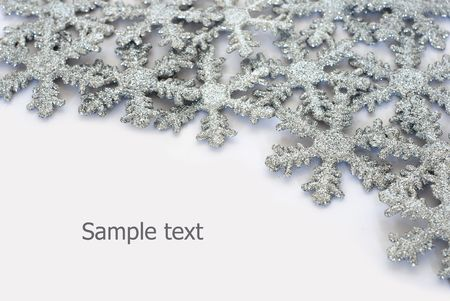 Sparkling snowflakes and place for sample text