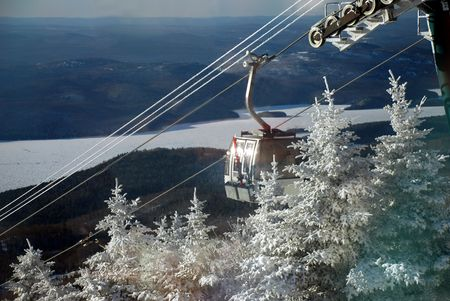 Ski lift cabin and snowy valley  photo