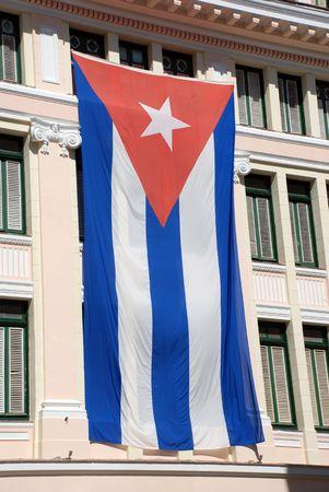 Facade of Old Havana building with cuban flag photo