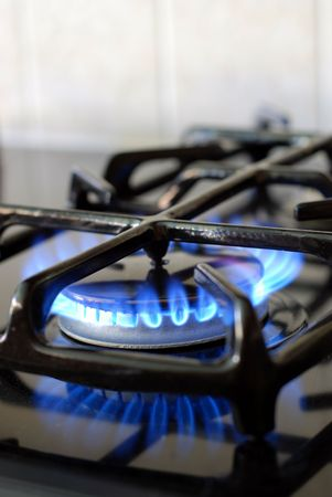 Burning gas oven in kitchen