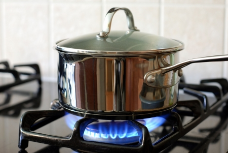 stove: Pot on the gas stove  Stock Photo