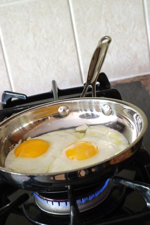 gas stove: Cooking eggs on a gas stove