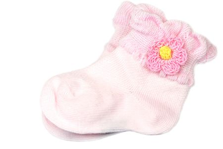 Pink baby socks on white Stock Photo