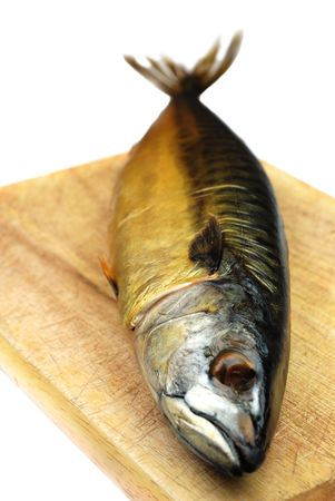 Smoked mackerel fish on a board