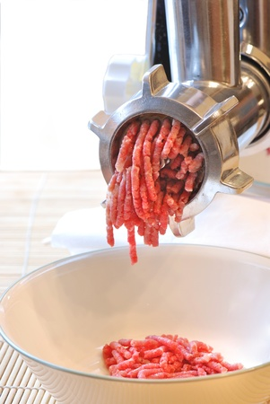 minced beef: Meat grinder at work