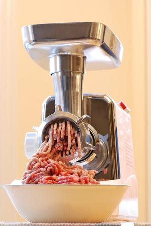 Meat grinder at work photo