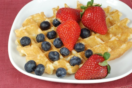 Belgian waffle with strawberry and blueberry photo
