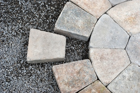 Installing decorative pavers in a circular pattern photo