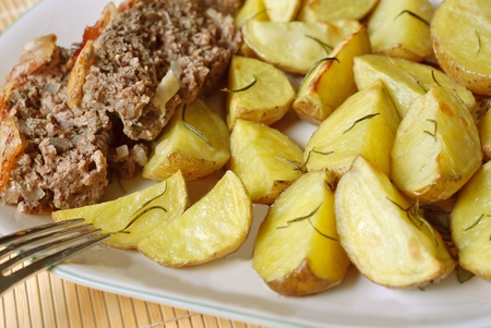 Potatoes roasted with rosemary and meatloaf photo